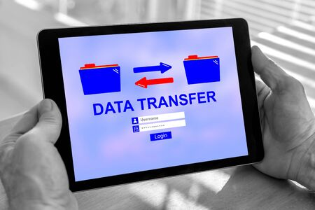Male hands holding a tablet with data transfer concept
