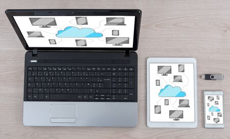 Cloud computing concept shown on different information technology devices