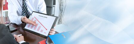 Businessman showing graph falling down; panoramic banner Stock Photo