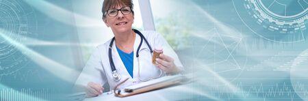 Female doctor holding a bottle of pills in medical office; panoramic banner Standard-Bild - 131489631