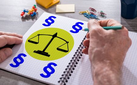 Hand drawing law concept on a notepad