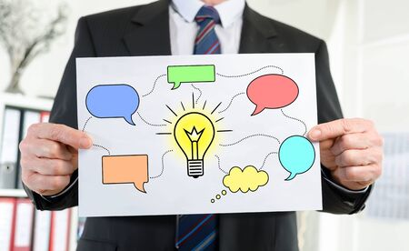 Paper showing idea concept held by a businessman