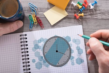 Time management concept drawn on a notepad placed on a desk