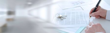 Client signing a real estate contract in real estate agency; panoramic banner