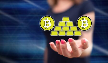 Bitcoin virtual gold concept above the hand of a woman in background