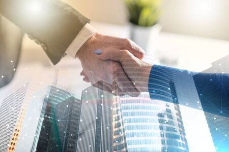 Handshake between businesswoman and businessman; multiple exposure Stock Photo