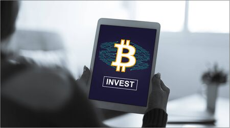 Tablet screen displaying a bitcoin concept