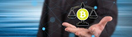 Bitcoin regulation concept above the hand of a man in background