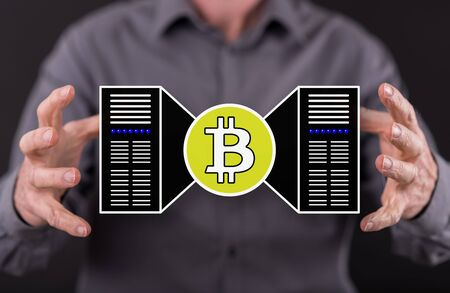 Bitcoin mining concept between hands of a man in background