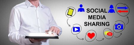 Man using a tablet with social media sharing concept Zdjęcie Seryjne