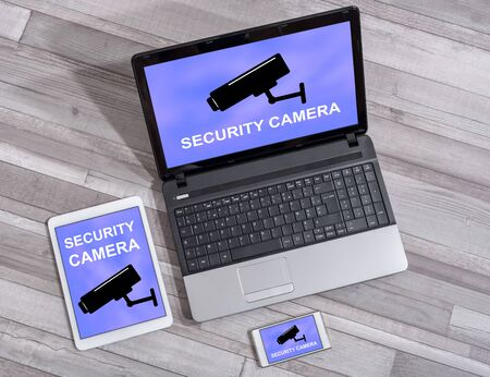 Security camera concept shown on different information technology devices Stock Photo