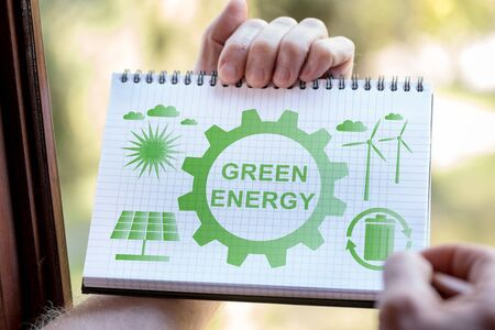 Hand drawing green energy concept on a notepad Standard-Bild - 133500555