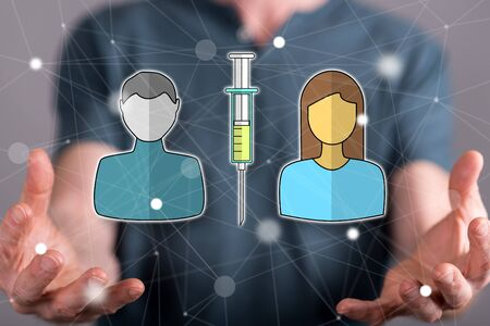 Vaccination concept between hands of a man in background