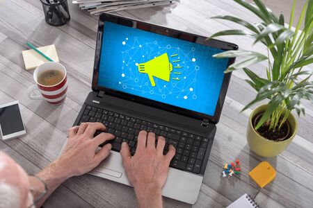 Man using a laptop with communication network concept on the screen
