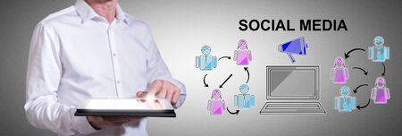 Man using a tablet with social media concept