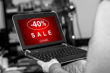 Tablet screen displaying a sale concept