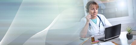 Portrait of mature female doctor during online medical consultation; panoramic banner Stock Photo