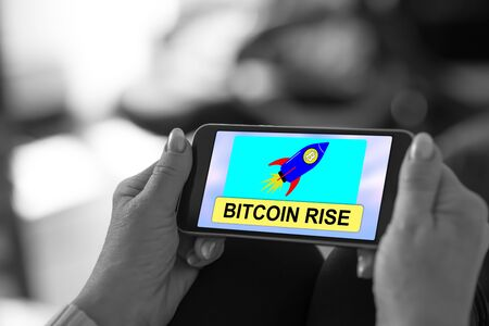 Smartphone screen displaying a bitcoin rise concept