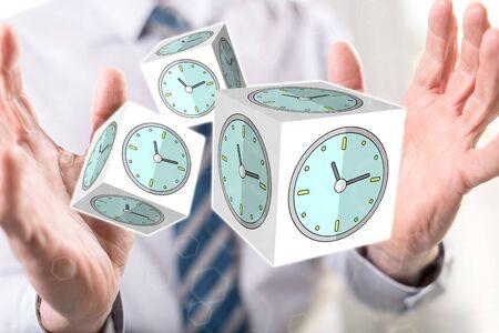 Time management concept between hands of a man in background Reklamní fotografie