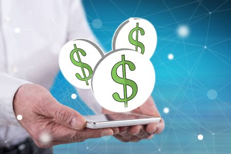 Dollar concept above a smartphone held by hands Stock fotó - 133700431