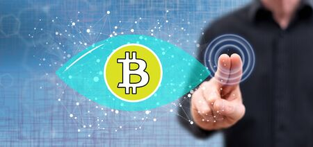 Man touching a bitcoin concept on a touch screen with his fingers Stock fotó - 133700440