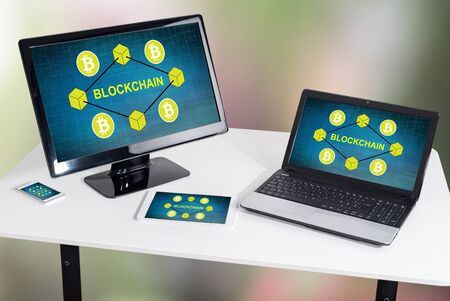 Blockchain concept shown on different information technology devices