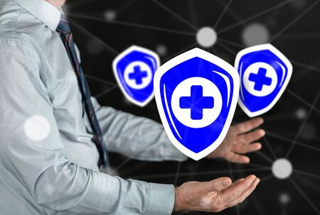 Health protection concept above the hands of a man