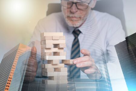 Concept of business risk with domino blocks; multiple exposure Stockfoto