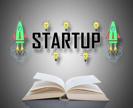 Startup concept above an open book