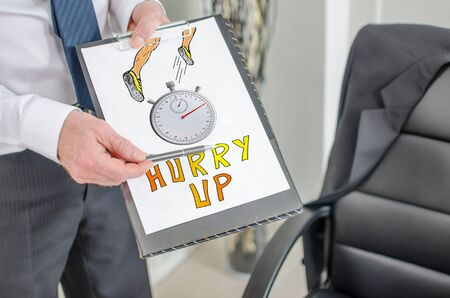 Businessman showing deadline concept on a clipboard