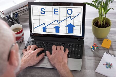 Seo concept shown on a laptop used by a man Stock Photo