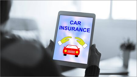 Tablet screen displaying a car insurance concept