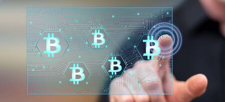 Man touching a bitcoin concept on a touch screen with his finger Reklamní fotografie
