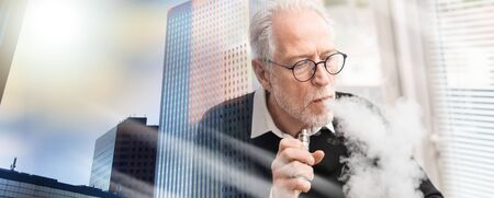 Portrait of senior man smoking electronic cigarette; multiple exposure