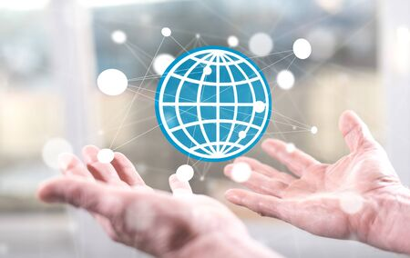 Global business concept above the hands of a man