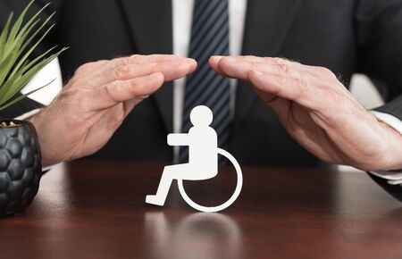 Insurer protecting a disabled person with his hands