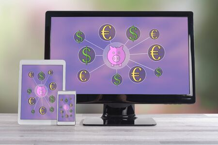 Money saving concept shown on different information technology devices