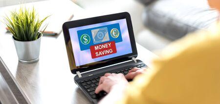Laptop screen displaying a money saving concept Imagens