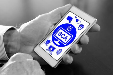 Hand holding a smartphone with sca concept