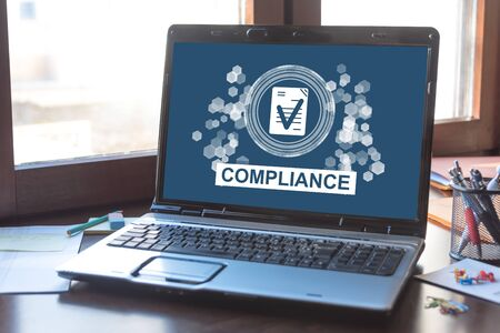Laptop screen displaying a compliance concept
