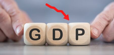 Concept of economic crash with GDP drop on wooden cubes