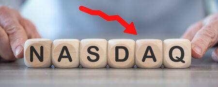 Concept of economic crash with nasdaq drop on wooden cubes