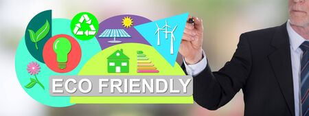 Businessman drawing an eco friendly concept Фото со стока