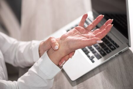 Businesswoman suffering from wrist pain