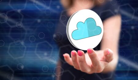 Cloud networking concept above the hand of a woman in background Zdjęcie Seryjne