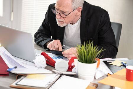 Businessman working on a cluttered and messy desk