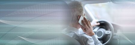 Man phoning while driving; panoramic banner Stock Photo