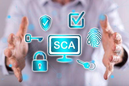 Sca concept between hands of a man in background
