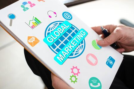 Global marketing concept on a paper held by a hand