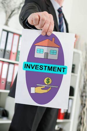 Paper showing investment concept held by a businessman Reklamní fotografie